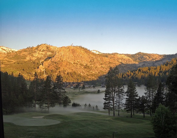 Squaw Valley without snow. The golf course is covered with early morning fog