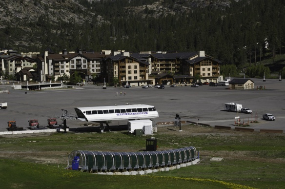 Ski Lifts and slope grooming equipment sit idle for the summer tourist season.
