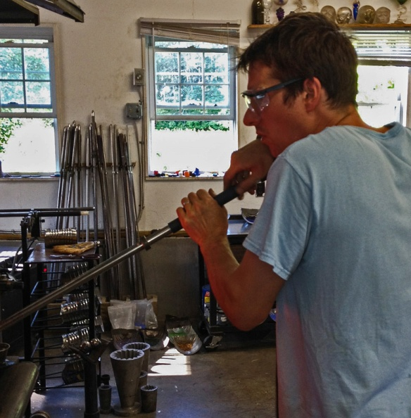 Glass Blower Gathering Molten Glass For A New Piece.