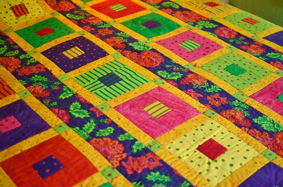 Celebrate, Cotton quilt with fall colors. Quilter,  Joanne Nolt; Fabric design by, Yvonne Porcella.