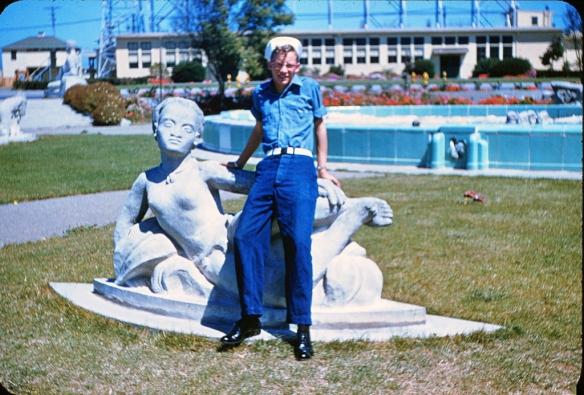 Sailor relaxing with mermaid, Treasure Is. 1953