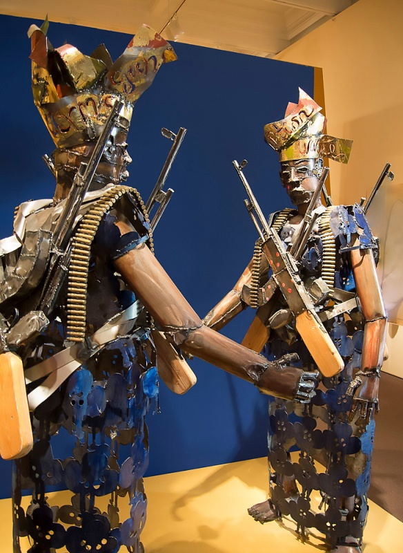 Satirical sculpture, Two Nigerian Woman with AK-47s and Cartridges
